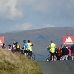 """Spectators and marshals wait at the top of the Tatham Fells """"King of the Mountain"""" stage (RW)"""
